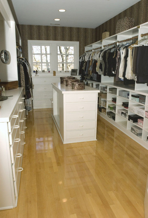This Case Design/Remodeling Indy Closet Enjoys Plenty Of Natural Light. A  Master Bedroom Window Was Integrated Into The Design When The Closet Was  Added.